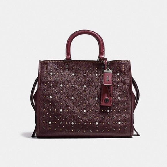 b2b555931e97 Never used women s Rogue handbag